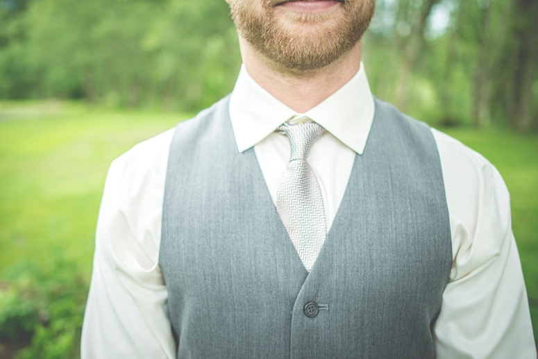Groom in grey by JS photography