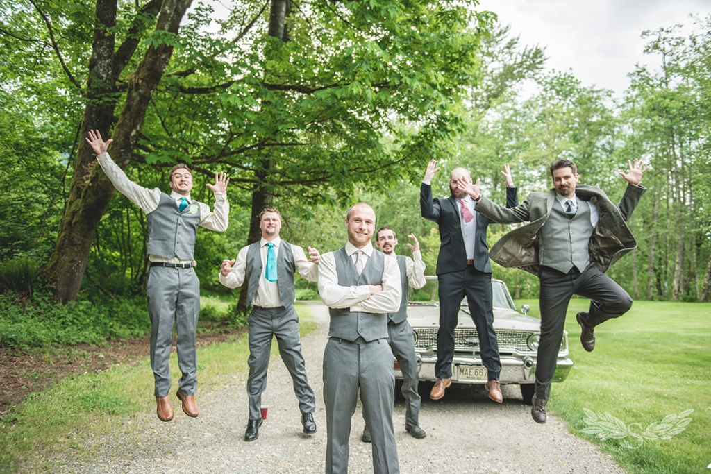 groomsmen-jumping-by-classic-car-in-vintage-wedding_BMP2425
