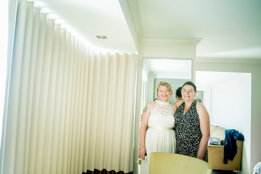 a casual indoor made of honor and bride photo
