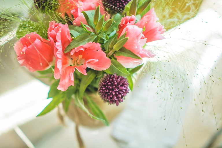 bridal bedroom was decorated with different types of flowers with spontaneous and natural designs