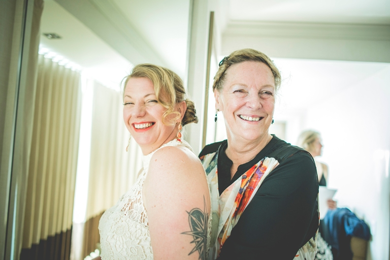 Bride and her mom in a casual setting, natural lighting and easy smiles