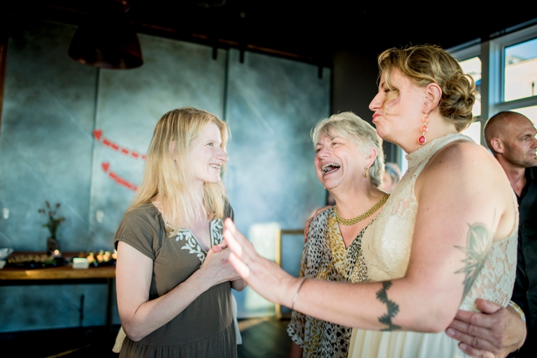 D+T bride taling to a guest at post Alley venue