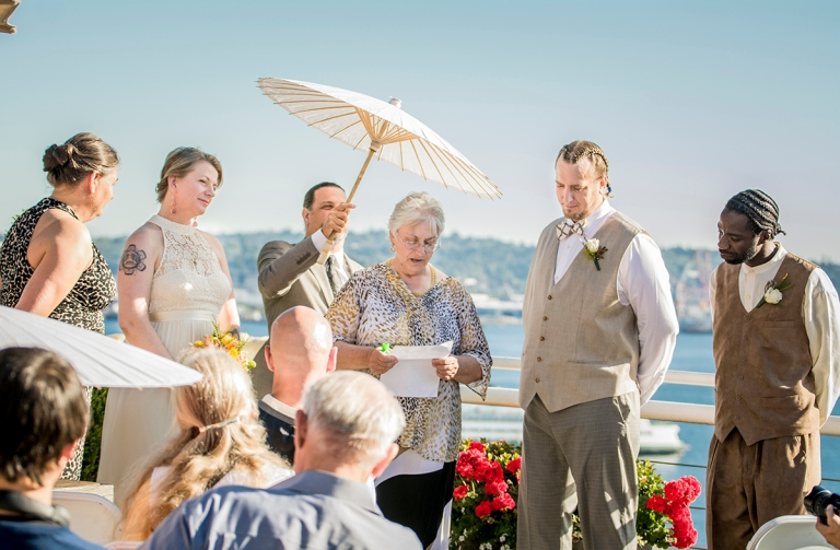 mother of the groom talking during the ceremony