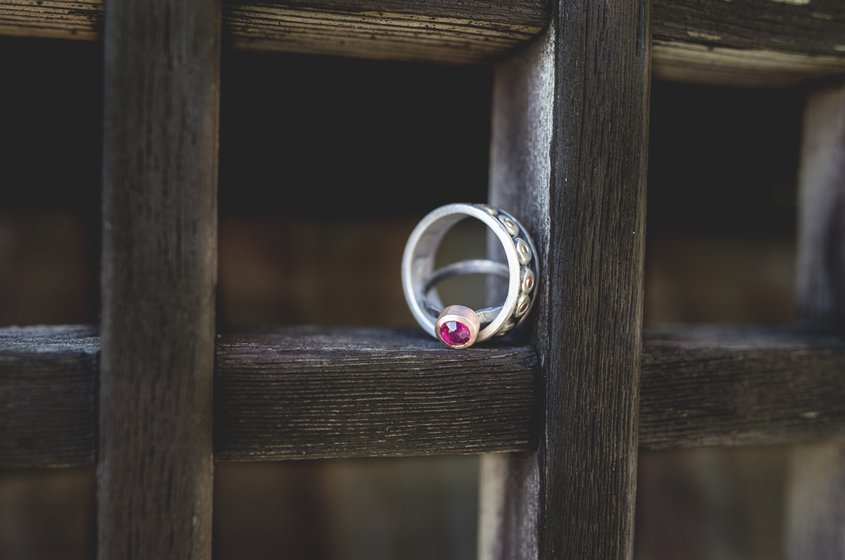 rings on wood with pink or red stone