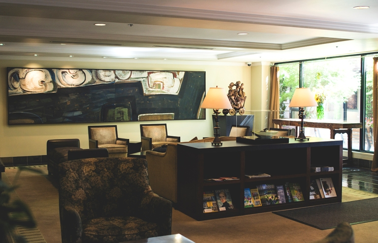 The lobby at the hotel near the Pike place is a contemporary mid century modern styled sitting area featuring many beautiful pieces of art