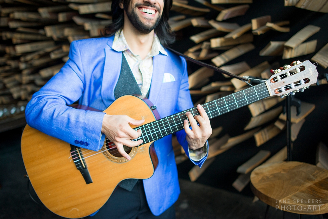 smile and guitar is all what this photo has at Wedding show in Seattle I DO SODO