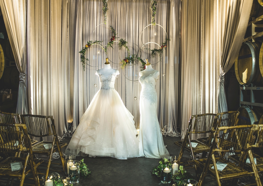 Wedding decor with drapes and bamboo chairs exhibition of two gowns in the middle of the room .jpg