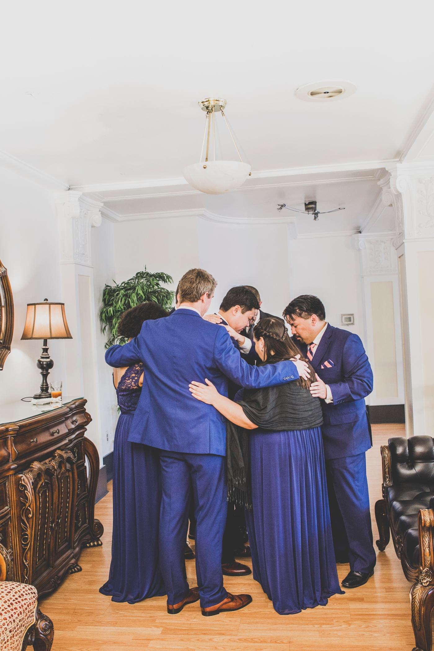 DSC_2385Everett_Wedding_Ballroom_Jane_Speleers_photography_Rachel_and_Edmund_Praying_2017