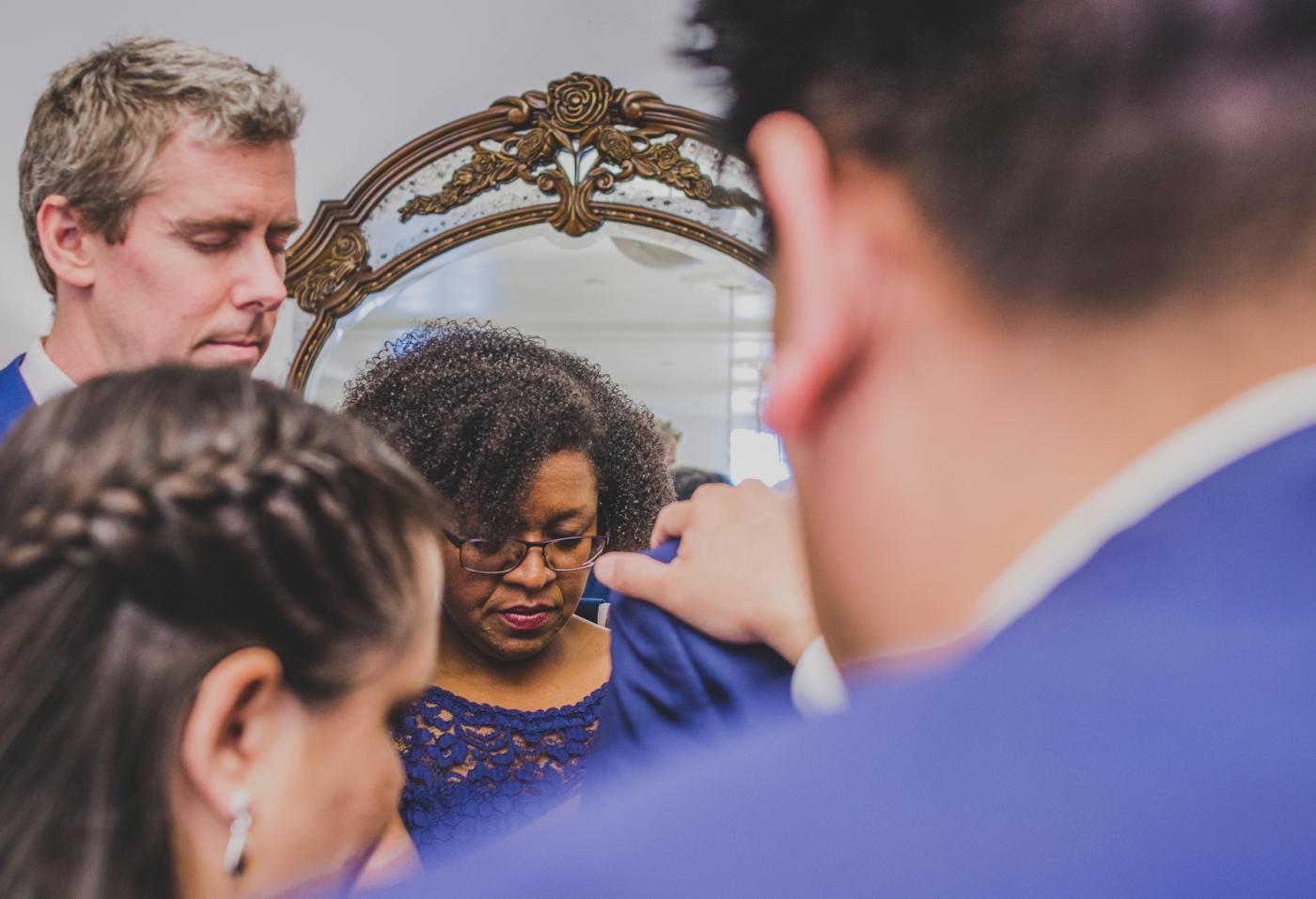 DSC_2394Everett_Wedding_Ballroom_Jane_Speleers_photography_Rachel_and_Edmund_Praying_2017