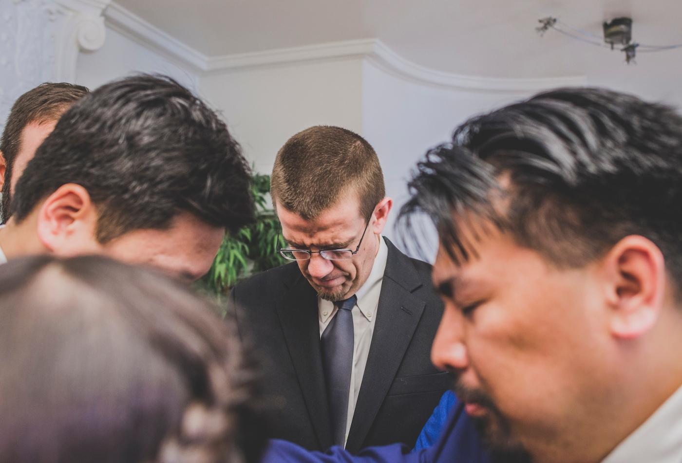 DSC_2395Everett_Wedding_Ballroom_Jane_Speleers_photography_Rachel_and_Edmund_Praying_2017